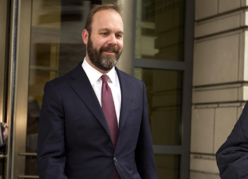 FILE - In this Feb. 23, 2018, file photo, Rick Gates leaves federal court in Washington. Paul Manafort's trial opened this week with a display of his opulent lifestyle and testimony about what prosecutors say were years of financial deception. But the most critical moment in the former Trump campaign chairman's financial fraud trial will arrive next week with the testimony of his longtime associate Gates.(AP Photo/Jose Luis Magana, File)