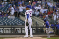 New York Mets starting pitcher Marcus Stroman stretches his arm after allowing a two-run home run to Chicago Cubs' Javier Baez, right, during the first inning of a baseball game Thursday, June 17, 2021, in New York. (AP Photo/Kathy Willens)