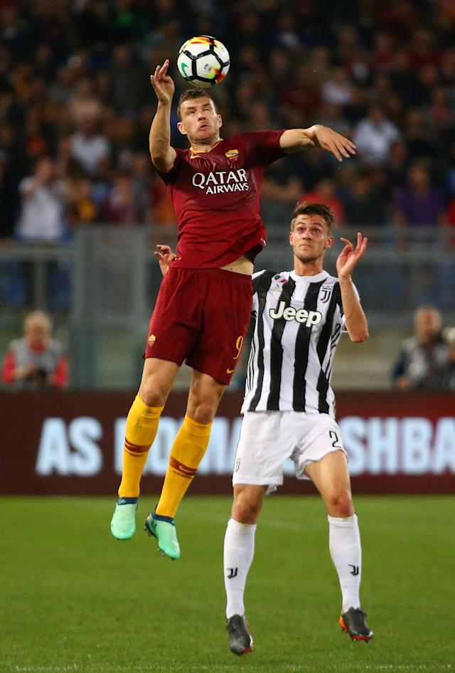 Soccer Football - Serie A - AS Roma vs Juventus - Stadio Olimpico, Rome, Italy - May 13, 2018 Roma's Edin Dzeko in action with Juventus' Daniele Rugani REUTERS/Alessandro Bianchi