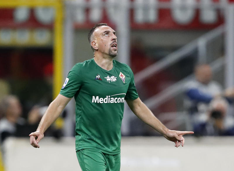 Fiorentina's Franck Ribery celebrates after scoring his side's third goal during a Serie A soccer match between AC Milan and Fiorentina, at the San Siro stadium in Milan, Italy, Sunday, Sept. 29, 2019. (AP Photo/Antonio Calanni)