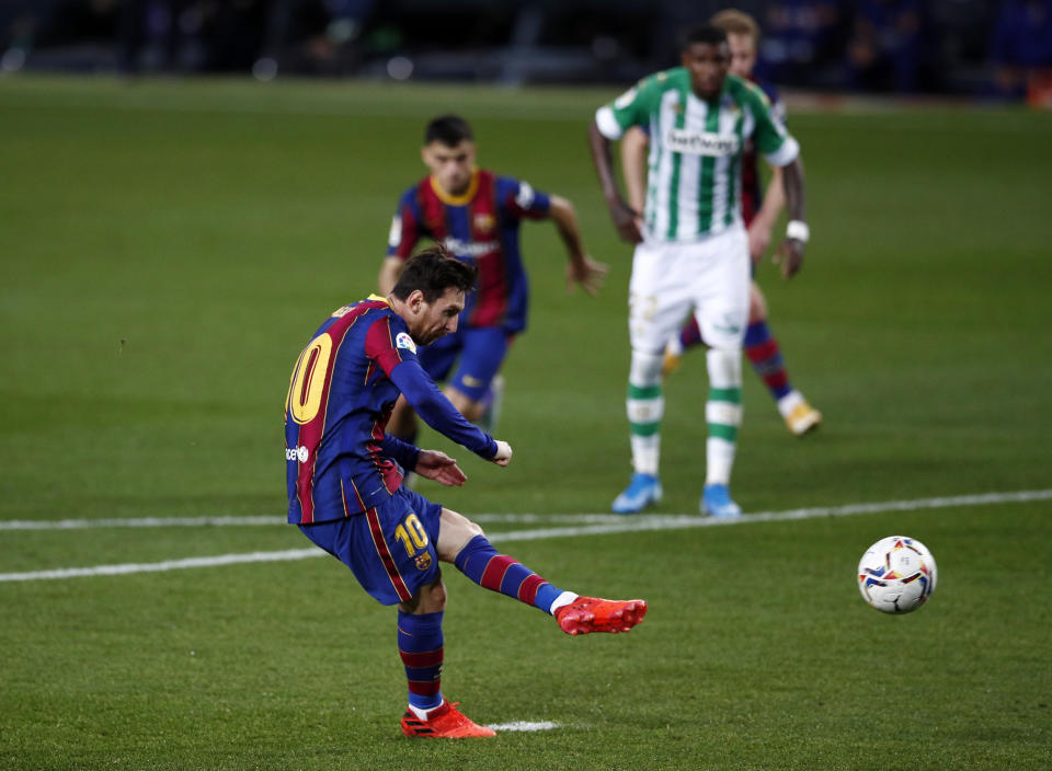 BARCELONA, SPAIN - NOVEMBER 07: Lionel Messi of FC Barcelona scores a penalty for his team's third goal during the La Liga Santader match between FC Barcelona and Real Betis at Camp Nou on November 07, 2020 in Barcelona, Spain. Sporting stadiums in Spain remain under strict restrictions due to the Coronavirus Pandemic as Government social distancing laws prohibit fans inside venues resulting in games being played behind closed doors. (Photo by Eric Alonso/Getty Images)