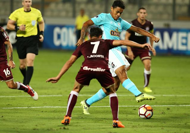 Soccer Football - Peru's Sporting Cristal v Argentina's Lanus - Copa Sudamericana - Nacional Stadium, Lima, Peru - March 7, 2018. Christopher Olivares of Sporting Cristal and Lautaro Acosta of Lanus in action. REUTERS/Mariana Bazo