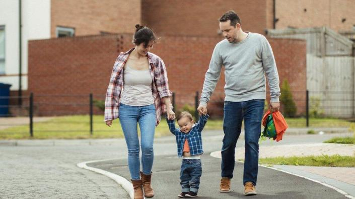 Family walking in the road