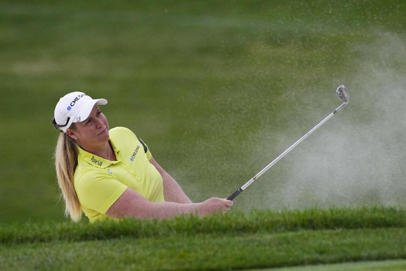 Brittany Lincicome of the US hits her third shot on the third hole during the third round of the Wegmans LPGA Championship, at Monroe Golf Club in Pittsford, New York, on August 16, 2014