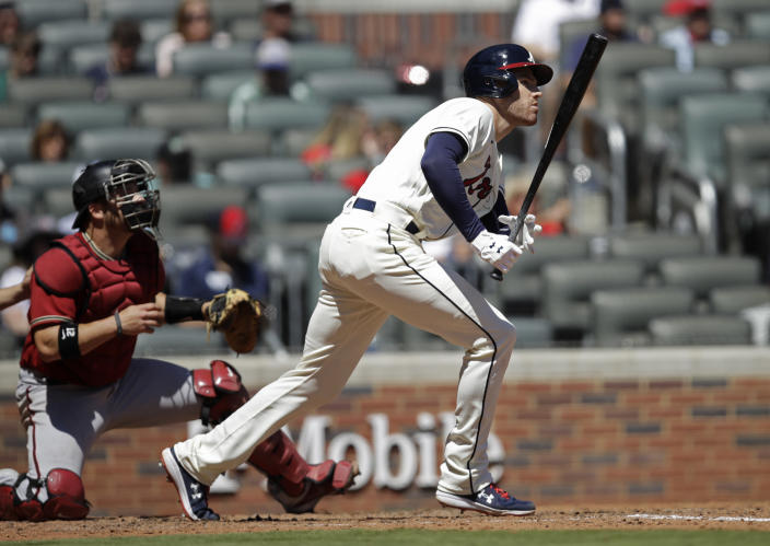 Atlanta Braves' Freddie Freeman swings for a single against the Arizona Diamondbacks in the sixth inning of the first baseball game of a double header, on Sunday, April 25, 2021, in Atlanta. (AP Photo/Ben Margot)