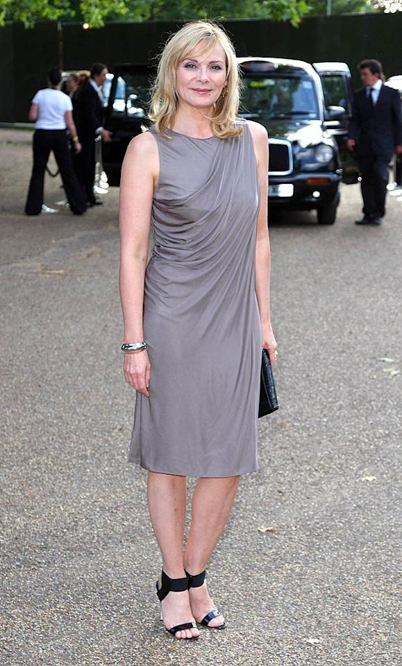"""51 and fabulous! Kim Cattrall looked beyond glam in a gathered gray dress while attending Nelson Mandela's 90th birthday bash at London's Hyde Park. Gareth Cattermole/<a href=""""http://www.gettyimages.com/"""" target=""""new"""">GettyImages.com</a> - June 25, 2008"""