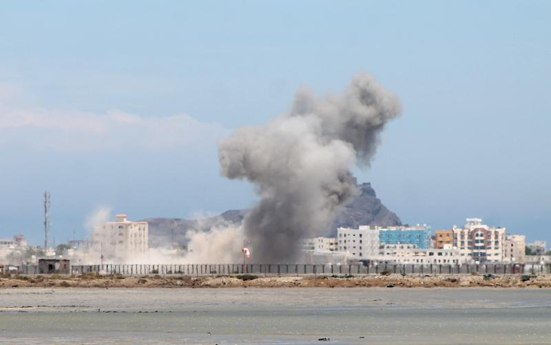 Smoke billows as supporters of exiled Yemeni leader Abedrabbo Mansour Hadi continue to clash with Shiite Huthi rebels in the Khor Maksar neighbourhood of Aden, on May 3, 2015