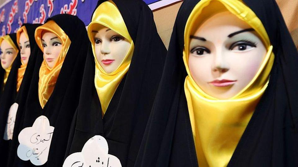 Headscarves are displayed on mannequins at the Islamic fashion exhibit in central Tehran on December 18, 2014.