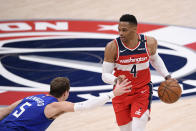 Washington Wizards guard Russell Westbrook (4) dribbles against Los Angeles Clippers guard Luke Kennard (5) during the first half of an NBA basketball game, Thursday, March 4, 2021, in Washington. (AP Photo/Nick Wass)