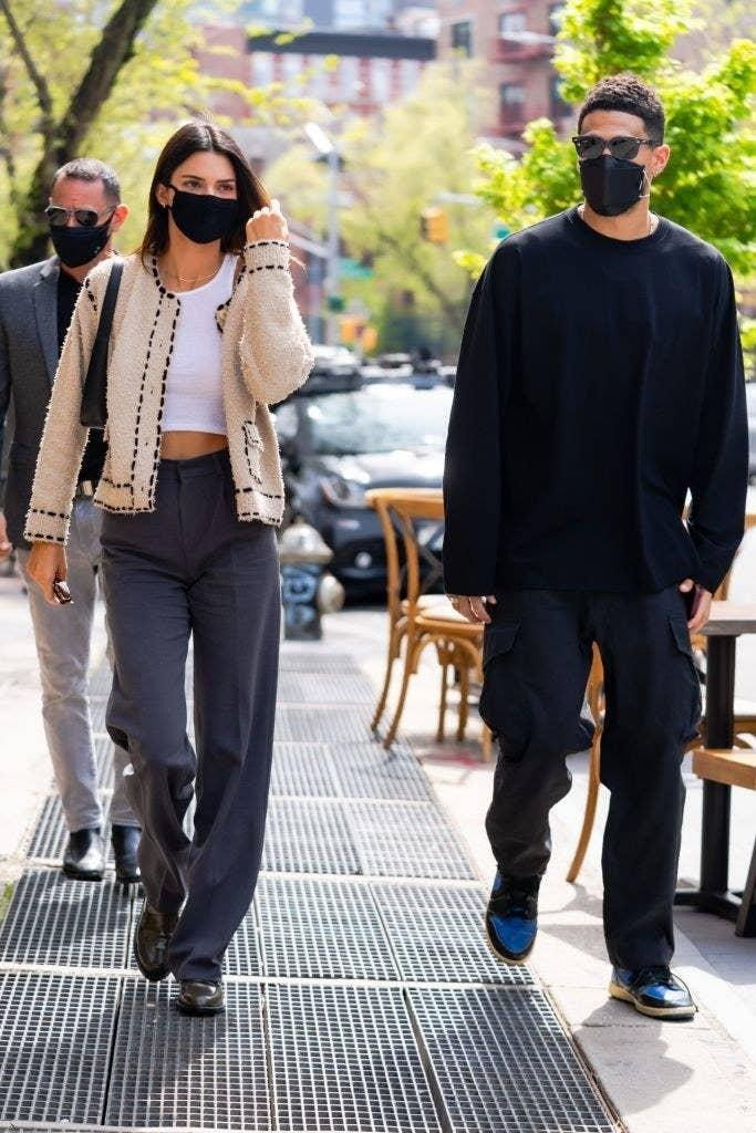 Kendall and Devin walking outside with their face masks on