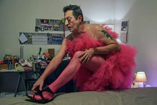 Brazilian drag queen Fernando Magrin, known as Mama Darling, gets dressed at his home in downtown Sao Paulo on February 14