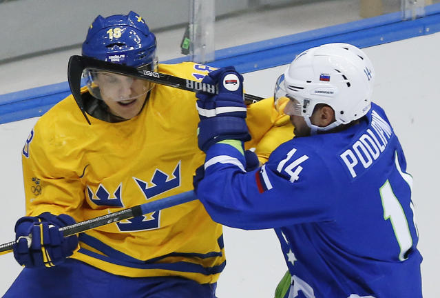 Sweden forward Jakob Silfverberg, left, scrambles against Sovenia defenseman Matic Podlipnik in the third period of a men's ice hockey game at the 2014 Winter Olympics, Wednesday, Feb. 19, 2014, in Sochi, Russia. Sweden won 5-0. (AP Photo/Mark Humphrey)