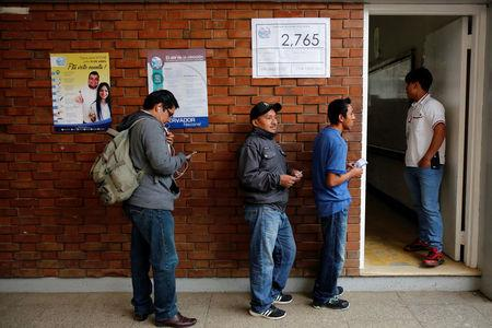 Residents wait in a queue to vote at a polling station during a referendum on a border dispute with Belize in Mixco, on the outskirts of Guatemala City, Guatemala April 15, 2018. REUTERS/Luis Echeverria
