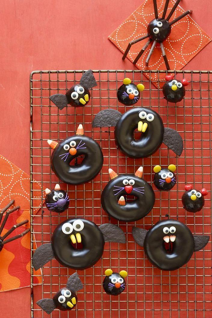 """<p>Don't worry about baking your own doughnuts at home. You can spruce up frosted, store-bought ones to look like cats, spiders, and mice.</p><p><strong><em><a href=""""https://www.womansday.com/food-recipes/food-drinks/a23460042/black-cat-bat-spider-and-mice-doughnuts-recipe/"""" rel=""""nofollow noopener"""" target=""""_blank"""" data-ylk=""""slk:Get the Black Cat, Bat, Spider, and Mice Doughnuts recipe."""" class=""""link rapid-noclick-resp"""">Get the Black Cat, Bat, Spider, and Mice Doughnuts recipe. </a></em></strong></p>"""