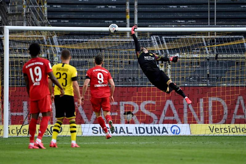 Dortmund's Swiss goalkeeper Roman Bürki fails to keep out Joshua Kimmich's delicious chipped finish.