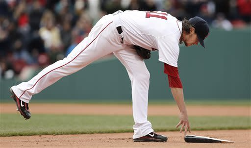 Boston Red Sox starting pitcher Clay Buchholz picks up the broken bat of Tampa Bay Rays' Kelly Johnson after Johnson got the first hit of the game off of Buchholz during the eighth inning of a baseball game at Fenway Park in Boston Sunday April 14, 2013. (AP Photo/Winslow Townson)