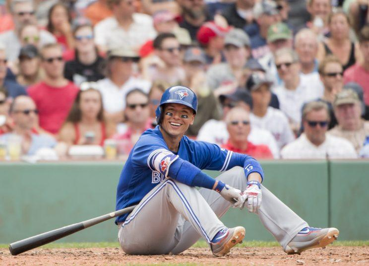 All Ryan Goins could do was smile after his unusual groundout. (Getty Images)