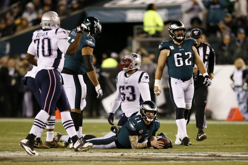 Philadelphia Eagles' Carson Wentz (11) lies on the field after being tackled by New England Patriots' Kyle Van Noy (53) during the first half of an NFL football game, Sunday, Nov. 17, 2019, in Philadelphia. (AP Photo/Michael Perez)