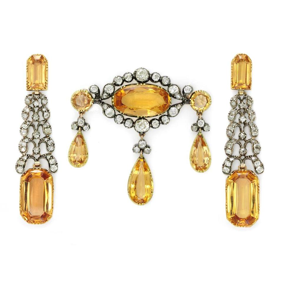 "<p>simonteakle.com</p><p><a href=""https://www.simonteakle.com/jewelry/antique-imperial-topaz-and-diamond-demi-parure-circa-1770"" rel=""nofollow noopener"" target=""_blank"" data-ylk=""slk:Shop Now"" class=""link rapid-noclick-resp"">Shop Now</a></p><p>A pair of earrings and an oval brooch decorated with pear-shaped drops, both set with imperial topaz and diamonds, make an enchanting duo for an evening out. </p>"