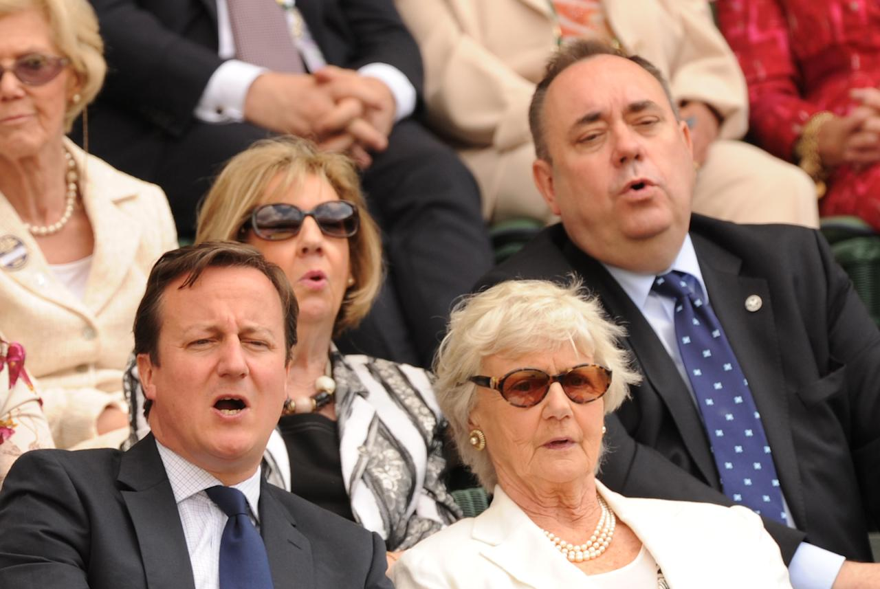 Britain's Prime Minister David Cameron (L), his mother Mary (R), First Minister of Scotland Alex Salmond (second row R) and his wife Moira (second row left) react to the action from the Royal Box on Centre Court during the men's singles final match between Britain's Andy Murray and Switzerland's Roger Federer on day 13 of the 2012 Wimbledon Championships tennis tournament at the All England Tennis Club in Wimbledon, southwest London, on July 8, 2012. AFP PHOTO / LEON NEAL      RESTRICTED TO EDITORIAL USELEON NEAL/AFP/GettyImages