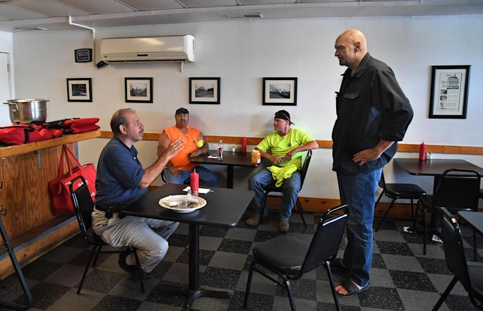 """<span class=""""s1"""">John Fetterman, right, strikes up a conversation at a diner in the depressed steel town of Clairton, Pa., in May. Fetterman is running for lieutenant governor on the Democratic ticket. (Photo: Michael S. Williamson/The Washington Post via Getty Images)</span>"""