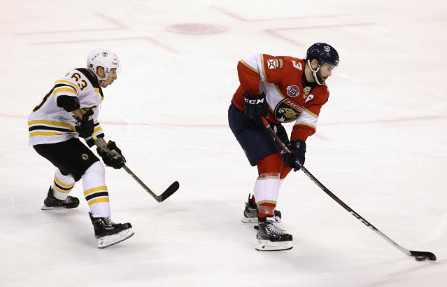 Florida Panthers' Keith Yandle (3) moves the puck as Boston Bruins' Brad Marchand, left, defends during the third period of an NHL hockey game, Saturday, March 23, 2019, in Sunrise, Fla. The Bruins won 7-3. (AP Photo/Luis M. Alvarez)
