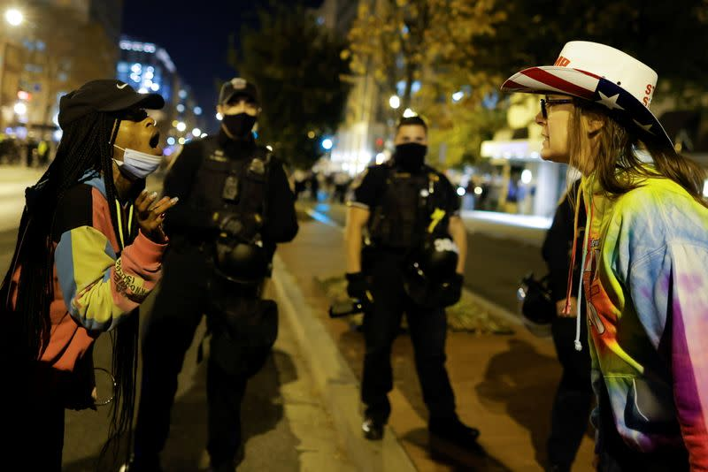 A supporter of U.S. President Donald Trump argues with an anti-Trump protester during the protest against election results in Washington