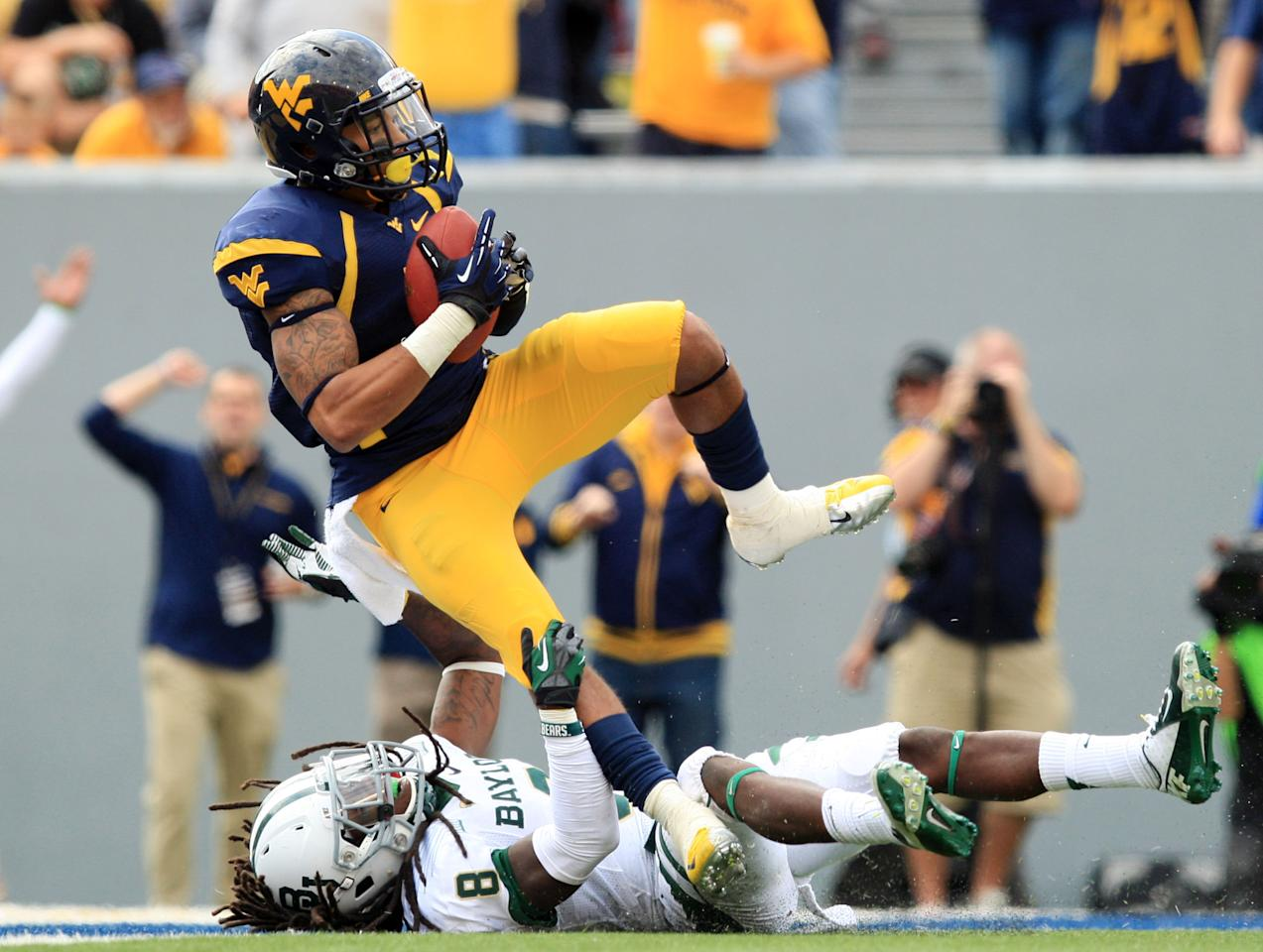 West Virginia's Stedman Bailey (3) is tackled in the endzone for a touchdown by Baylor's K.J. Morton (8) during their NCAA college football game in Morgantown, W.Va., Saturday, Sept. 29, 2012. (AP Photo/Christopher Jackson)