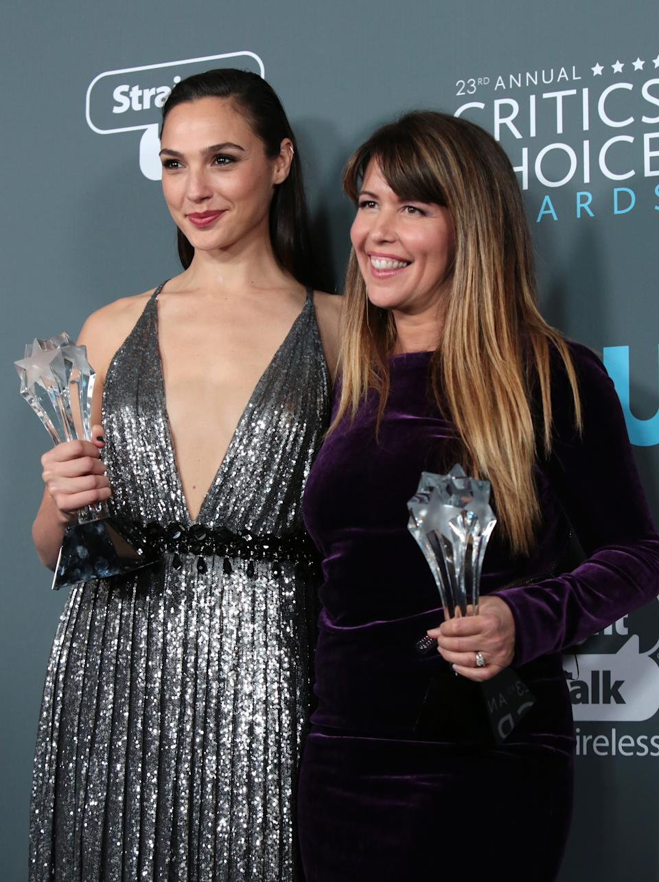 """23rd Critics' Choice Awards – Photo Room – Santa Monica, California, U.S.,11/01/2018– Gal Gadot (L) and Patty Jenkins pose with their award for Best Action Movie for """"Wonder Woman"""". REUTERS/Monica Almeida"""