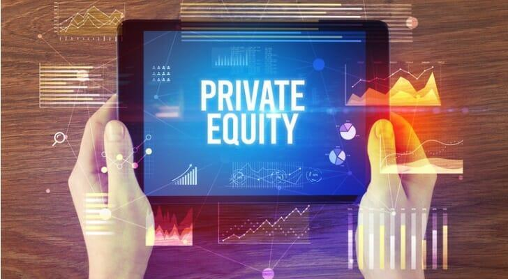 "Pair of hands holding an iPad with the words ""PRIVATE EQUITY"" on the screen"