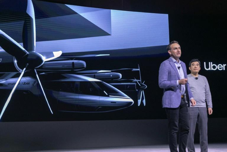 Eric Allison (L), Head of Uber Elevate, and Jaiwon Shin, Head of Urban Air Mobility at Hyundai, talk about their companies' partnership to create an air taxi network, during the 2020 Consumer Electronics Show (CES) in Las Vegas