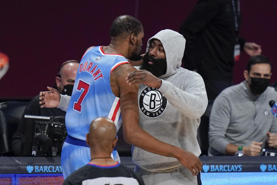 Brooklyn Nets' James Harden, right, hugs Kevin Durant before the first half of an NBA basketball game against the San Antonio Spurs Wednesday, May 12, 2021, in New York. (AP Photo/Frank Franklin II)