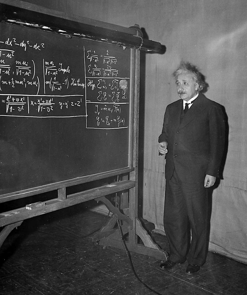 FILE - In this Dec. 28, 1934 file photo, Albert Einstein delivers a lecture at the meeting of the American Association for the Advancement of Science in the auditorium of the Carnegie Institue of Technology Little Theater at Pittsburgh. Scientists at the European Organization for Nuclear Research, or CERN, the world's largest physics lab, say they have clocked subatomic particles, called neutrinos, traveling faster than light, a feat that, if true, would break a fundamental pillar of science, the idea that nothing is supposed to move faster than light, at least according to Einstein's special theory of relativity: The famous E (equals) mc2 equation. That stands for energy equals mass times the speed of light squared. The readings have so astounded researchers that they are asking others to independently verify the measurements before claiming an actual discovery. (AP Photo)