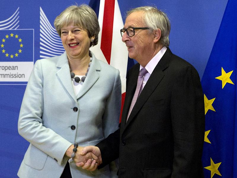 Theresa May with European Commission President Jean-Claude Juncker in Brussels on Friday: AP