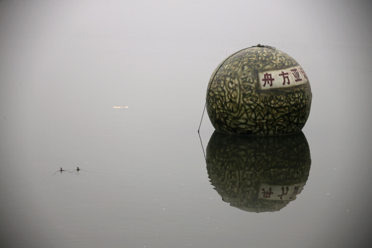 "A spherical pod, named ""Noah's Ark"", designed by Chinese inventor Liu Qiyuan floats on a river during a test in Xianghe, Hebei province, December 12, 2012. Liu, who has spent 1.8 million yuan ($288,000) on building six ""Noah's Ark""s in 8 months with the help of his former furniture factory's workers, is working on his seventh pod. The 17 cubic-metre volume vessels were built to serve as lifeboats in the event of earthquakes, tsunamis and floods. REUTERS/Petar Kujundzic (CHINA - Tags: SOCIETY SCIENCE TECHNOLOGY DISASTER ENVIRONMENT)"