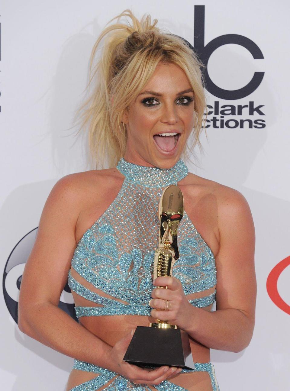 <p>Britney took home the Billboard Millennium Award <em>and </em>had the cutest hairstyle of the night with this messy high pony and curtain bangs.</p>