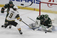Minnesota Wild's goalie Kaapo Kahkonen (34) blocks a shot-attempt by Vegas Golden Knights' Cody Glass (9) in the third period of an NHL hockey game Monday, March 8, 2021, in St. Paul, Minn. (AP Photo/Stacy Bengs)