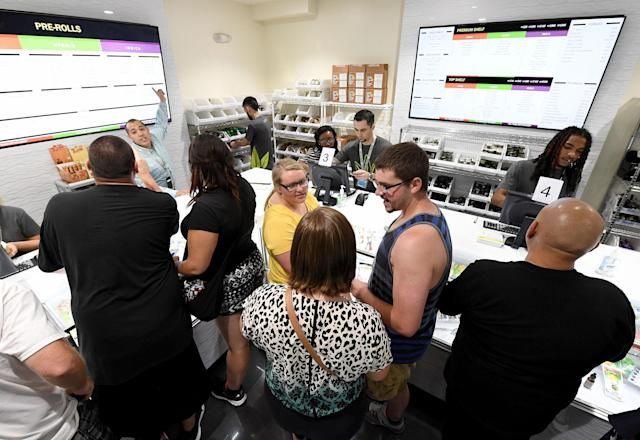 <p>Customers buy cannabis products at Essence Vegas Cannabis Dispensary after the start of recreational marijuana sales began on July 1, 2017 in Las Vegas, Nev. (Photo: Ethan Miller/Getty Images) </p>