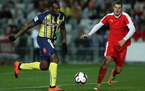 <span>Usain Bolt making his footballing debut for the Central Coast Mariners in Australia</span> <span>Credit: Ashley Feder/Getty Images </span>