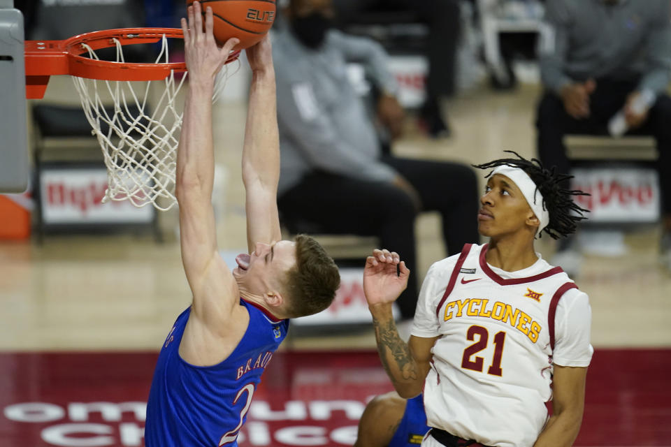 Kansas guard Christian Braun drives to the basket ahead of Iowa State guard Jaden Walker (21) during the second half of an NCAA college basketball game, Saturday, Feb. 13, 2021, in Ames, Iowa. Kansas won 64-50. (AP Photo/Charlie Neibergall)