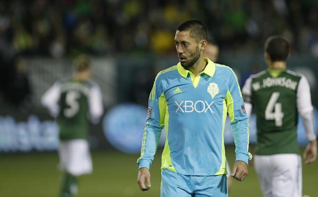 Seattle Sounders' Clint Dempsey walks off the pitch after the Portland Timbers beat the Sounders 3-2 in the second game of the Western Conference semifinals in the MLS Cup soccer playoffs, Thursday, Nov. 7, 2013, in Portland, Ore. The win gave the Timbers a 5-3 aggregate score in the two-match series. The Timbers will advance to the Western Conference semifinals against Real Salt Lake. (AP Photo/Ted S. Warren)