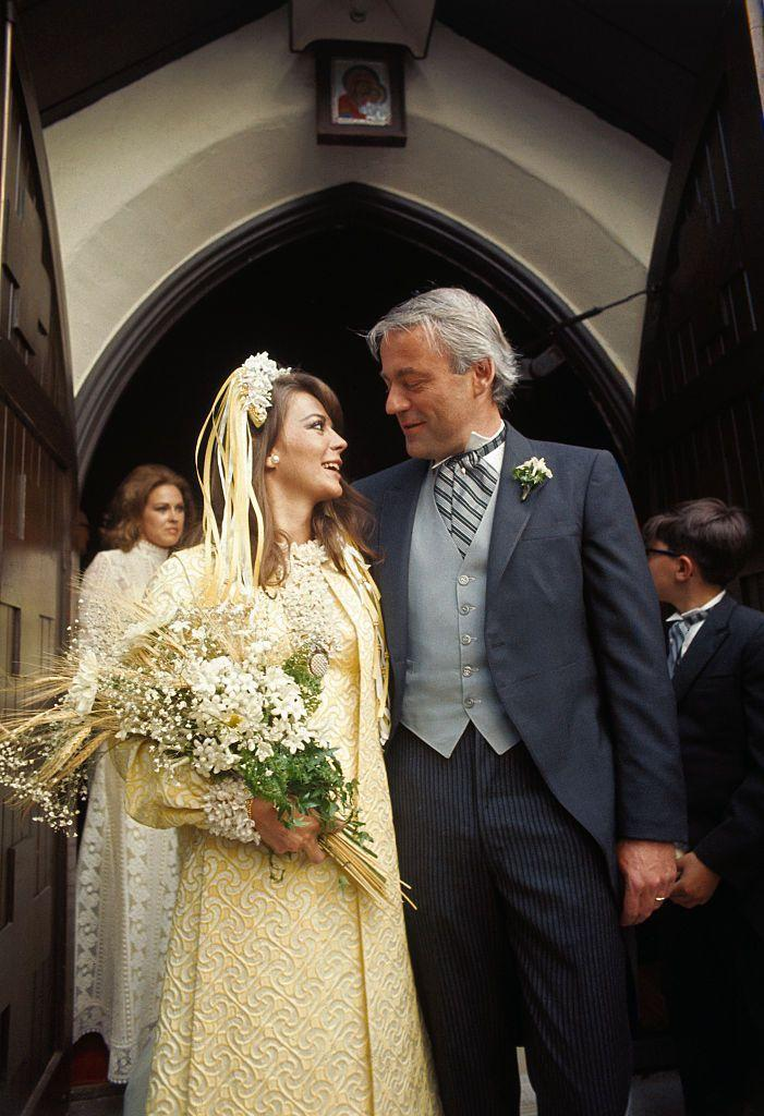<p>Never one to be conventional, Natalie Wood chose a yellow embroidered dress, a matching coat, and a flower ribbon head piece for wedding to Richard Gregson. Though the bride stuck with one tradition: She carried a bouquet that included straws of wheat, a common Russian bridal custom. </p>