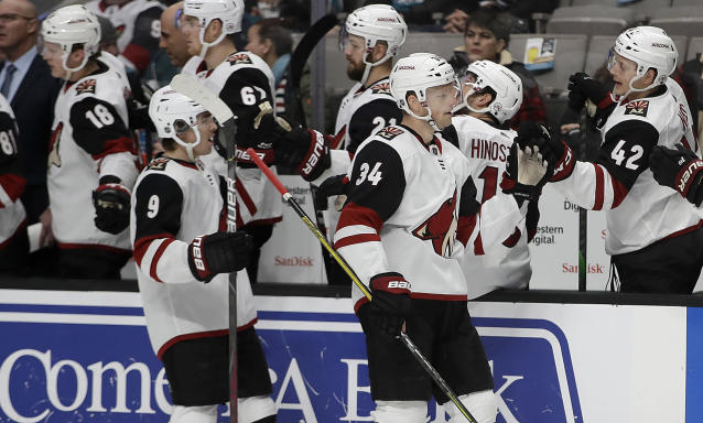 Arizona Coyotes' Carl Soderberg (34) is congratulated by Aaron Ness (42) after scoring against the San Jose Sharks in the first period of an NHL hockey game Tuesday, Dec. 17, 2019, in San Jose, Calif. (AP Photo/Ben Margot)