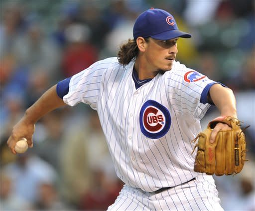 Chicago Cubs starter Jeff Samardzija delivers a pitch against the Houston Astros in the first inning during a baseball game in Chicago, Monday, Aug. 13, 2012. (AP Photo/Paul Beaty)