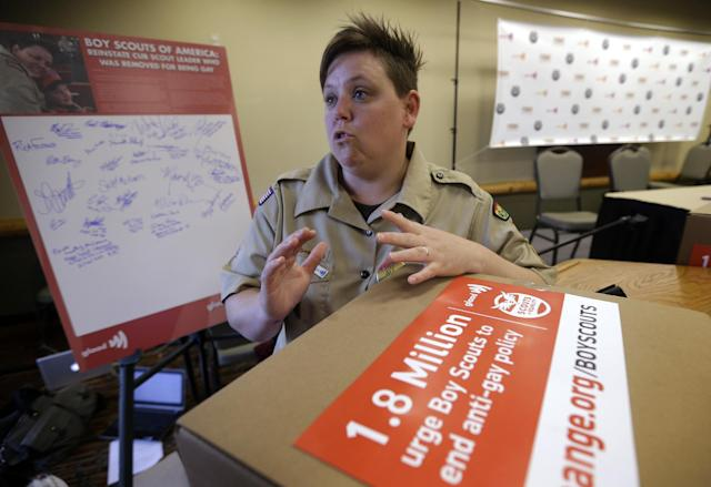 Former Cub Scouts den leader Jennifer Tyrrell, who was ousted from Scouting because she is openly gay, responds to a reporters question Thursday, May 23, 2013, in Grapevine, Texas. Local leaders of the Boy Scouts of America voted Thursday to ease a divisive ban and allow openly gay boys to be accepted into the nation's leading youth organization — one of the most dramatic moves the organization has made in a century. (AP Photo/Tony Gutierrez)