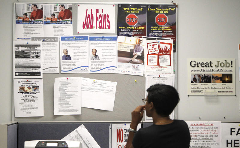 A job seeker looks at a bulletin at the Texas Workforce Commission's Workforce Solutions of Greater Dallas job resource center in Richardson, Texas Tuesday, July 5, 2011. The number of people applying for unemployment benefits fell last week to the lowest level in seven weeks, although applications remain elevated.  (AP Photo/LM Otero)