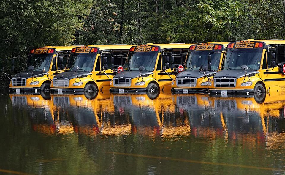 Waltham, MA – September 2: Waltham school busses looked more like moored boats off Lexington Street in Waltham, MA on Sept. 2, 2021. Flooding concerns due to the heavy rainfall from the remnants of Hurricane Ida shifted away from morning commute problems to communities along rivers in both Massachusetts and Rhode Island, where water levels were continuing to rise on Thursday. The overnight rainfall reached nearly 6 inches in some Massachusetts communities. (Photo by David L. Ryan/The Boston Globe via Getty Images)