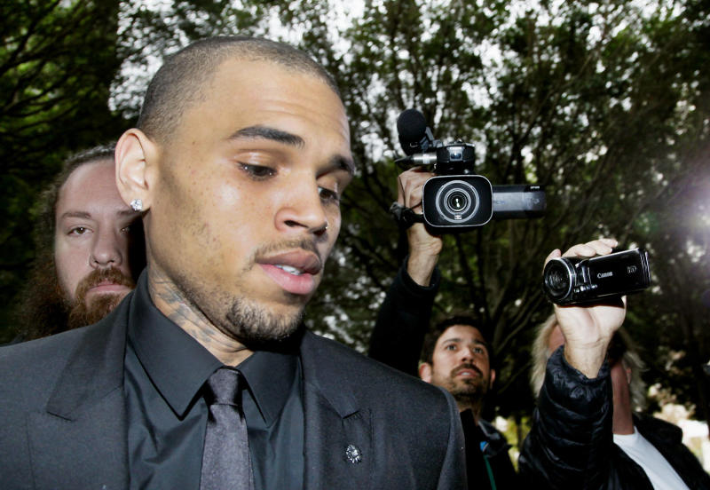 FILE - In this Wednesday, Nov. 20, 2013, file photo, singer Chris Brown arrives at court for a probation review hearing , in Los Angeles. A judge on Monday, Dec. 16, 2013, revoked Brown's probation after his recent arrest on suspicion of misdemeanor assault in Washington, D.C., but the ruling will not alter the singer's requirements to complete rehab and community labor for his 2009 attack on Rihanna. (AP Photo/ Nick Ut, File)