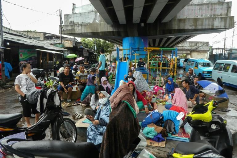 Jakarta residents hit by flooding took shelter from heavy rain under flyovers