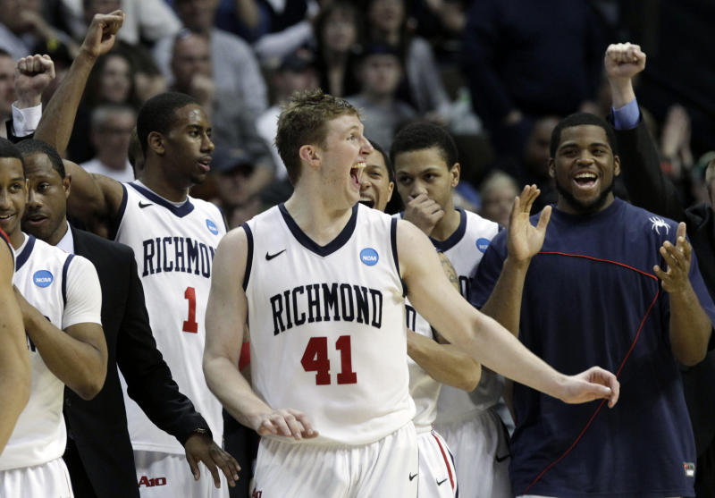 Richmond players celebrate at the end of the game after beating Morehead State 65-48 in a Southwest regional third round NCAA tournament college basketball game, Saturday, March 19, 2011, in Denver. (AP Photo/Ed Andrieski)